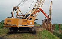 Liebherr crane used to drive steel sheet piles into the river bank