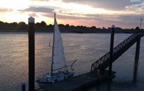 Boat mooring under sunset at the floating pontoon installed by Drake Towage in King's Lynn